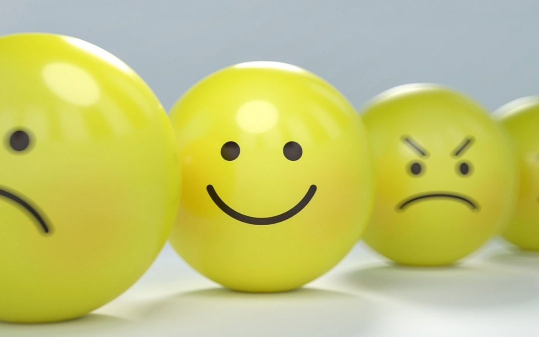 yellow smiley face ball among sad and angry balls representing service to others
