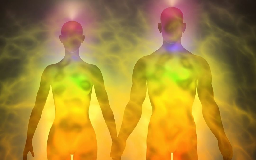 man and woman with chakras and energy around them representing your original energetic blueprint