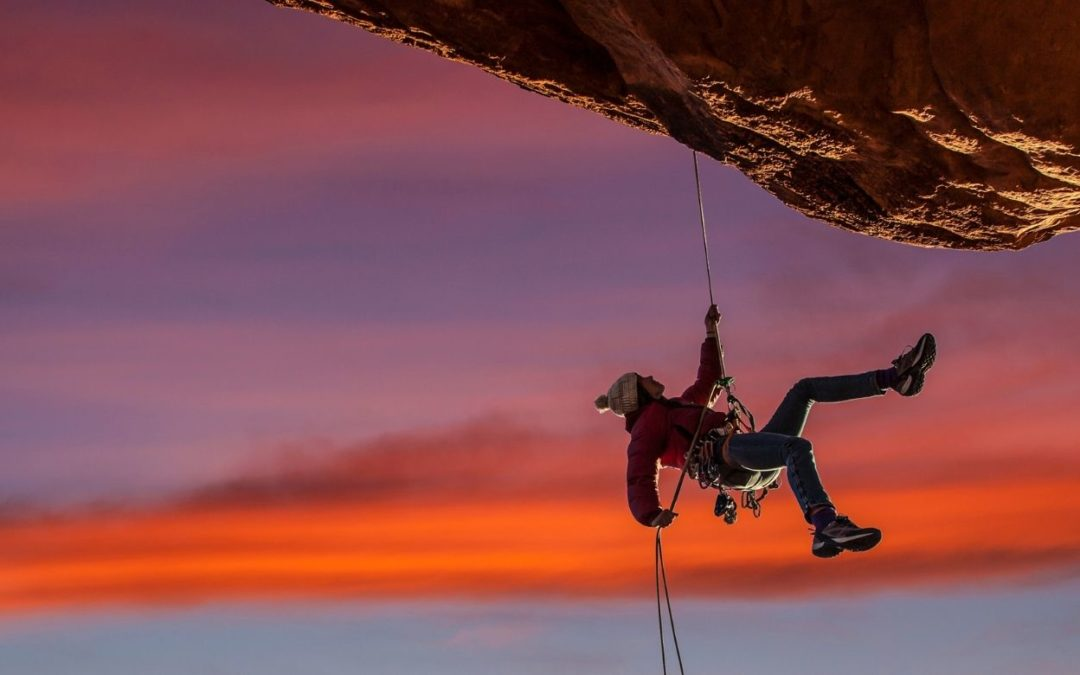 person rock climbing symbolizing fun in spite of restrictions
